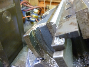 Milling one edge of the gib 422