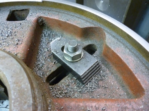 Using an existing hole in a workpiece for clamping 48