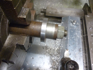 1019 arbor fitted with workpiece and turned to size